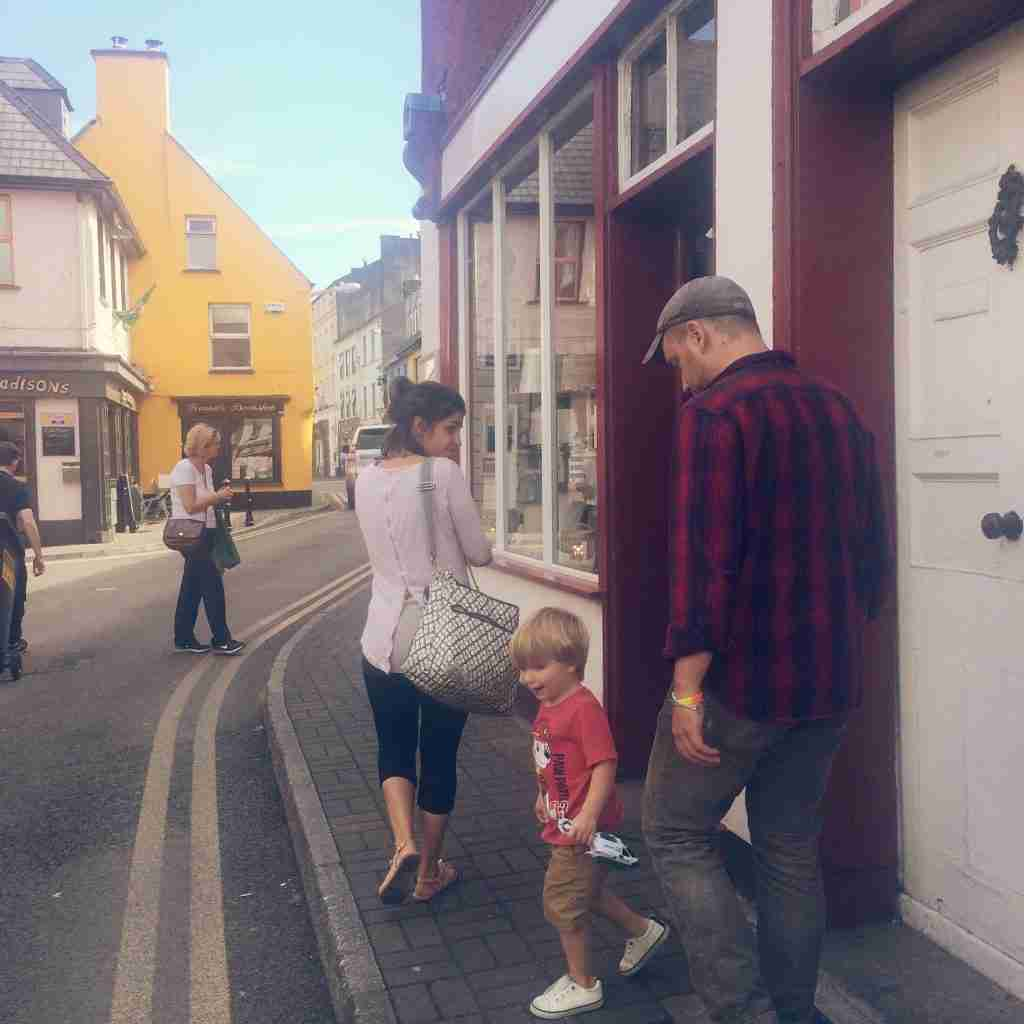 A family on a street in Kinsale in West Cork, Ireland