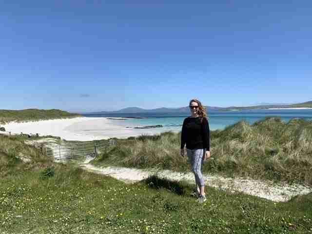 Solo female traveler on the Isle of Barra in Scotland