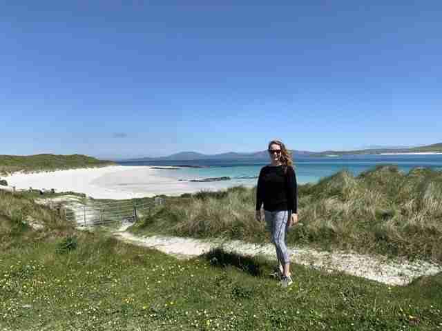 Solo female traveler on the Isle of Barra in Scotland