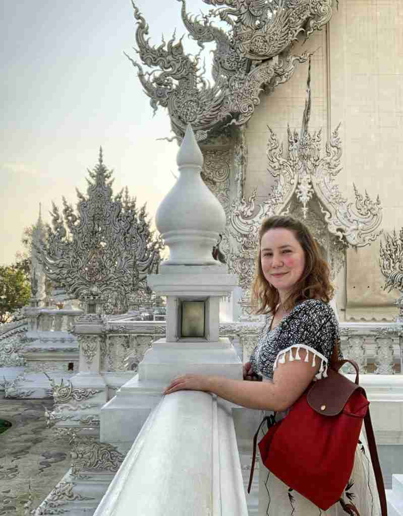 Solo female traveler in the White Temple in Chiang Rai, Thailand