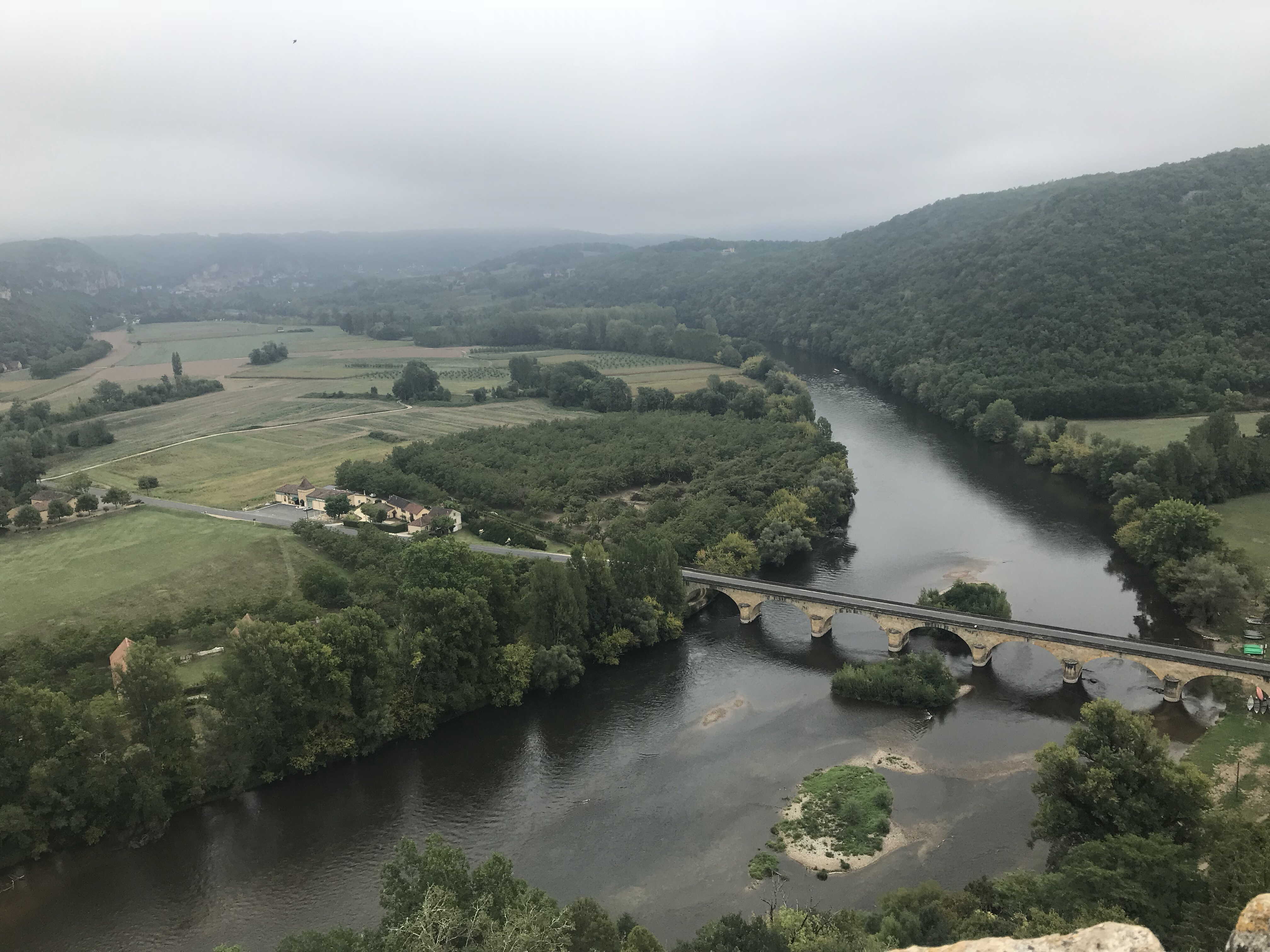 A foggy river valley in the Dordogne France