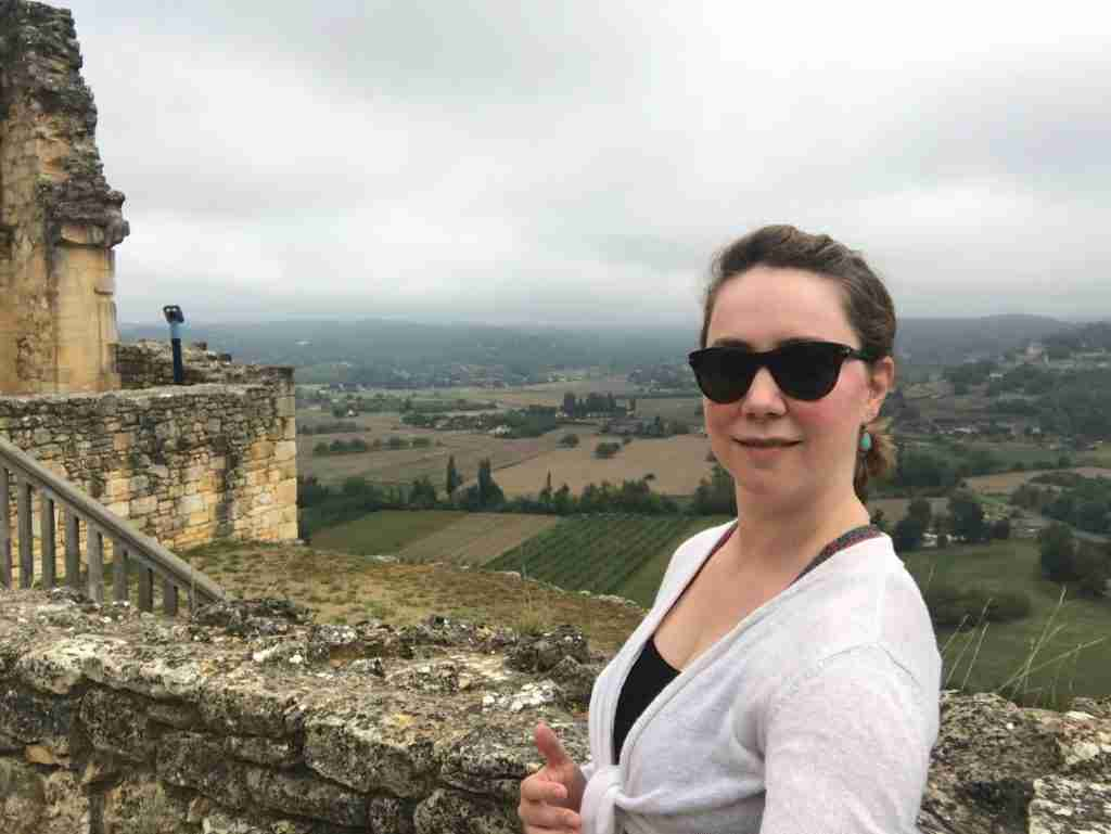 Solo female traveler at a chateau in the Dordogne, France