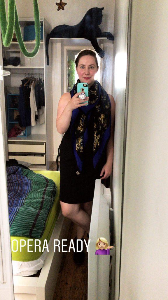 Solo female traveler dressed for the opera in Paris