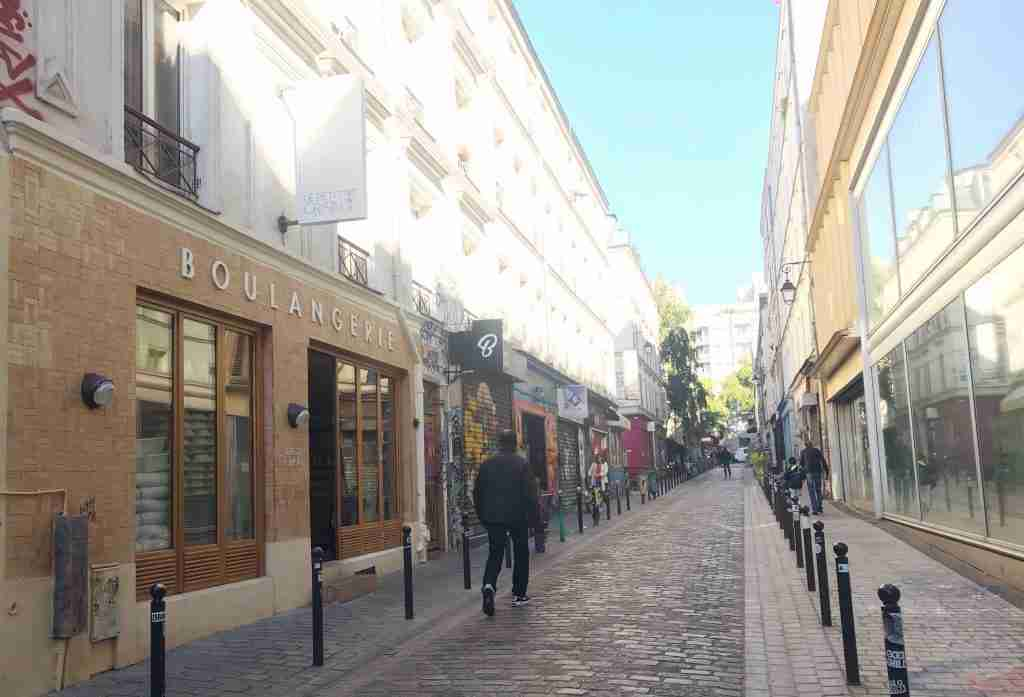 a side street in Belleville Paris 19th arrondissement with a bakery