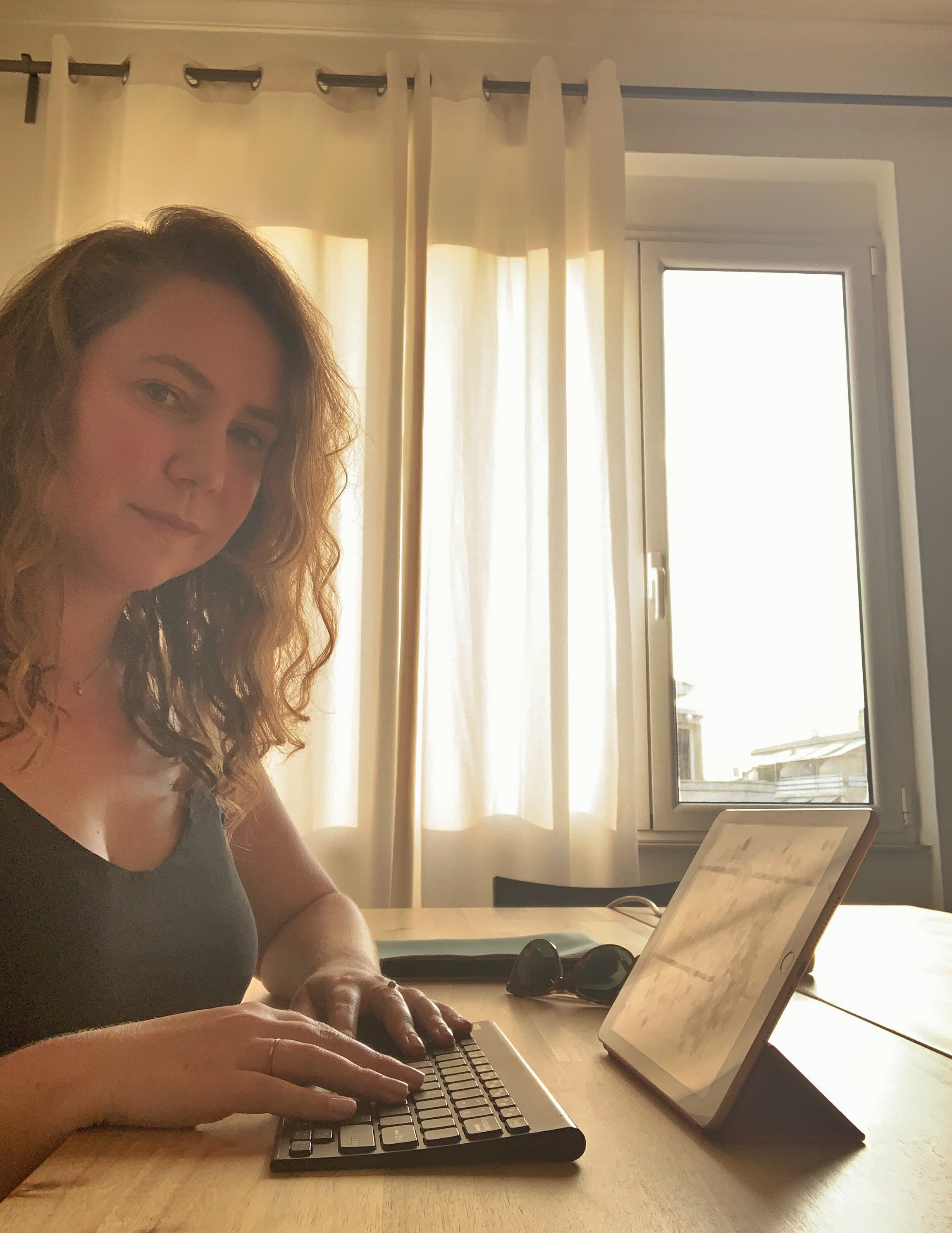 Female digital nomad writing in Athens Greece