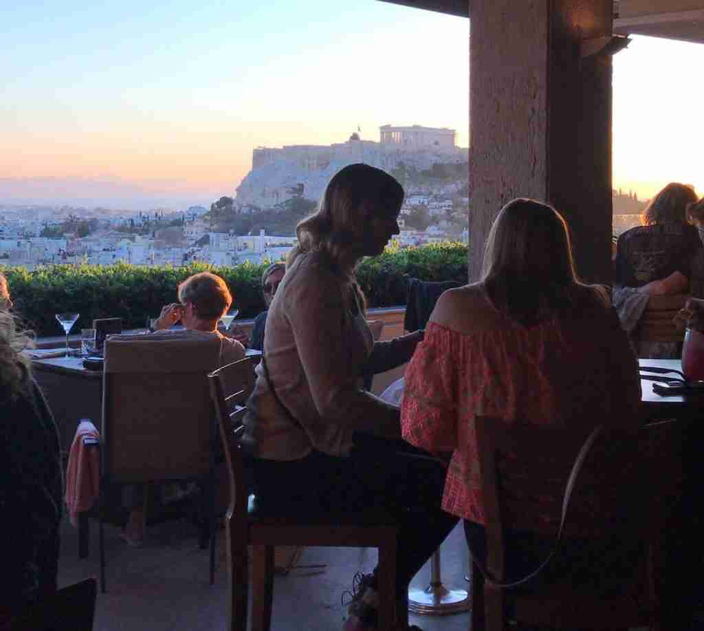 Sunset over the Acropolis from the Grande Bretagne Hotel rooftop bar in Athens Greece