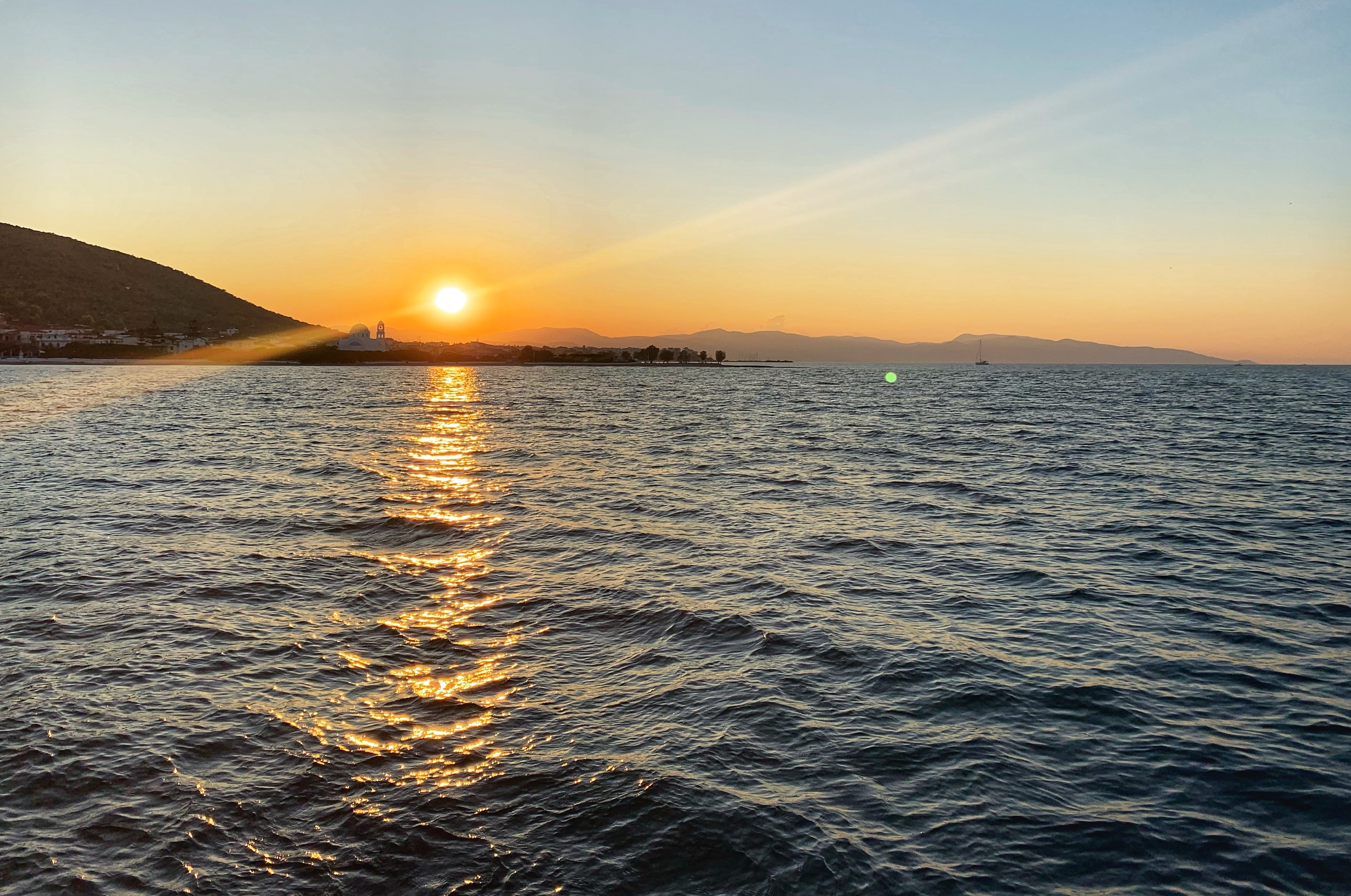 Sunset over the Greek island of Aegistri solo female travel blog