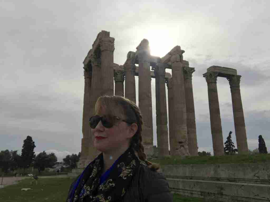 Solo female traveler at the Temple of Zeus in Athens, Greece