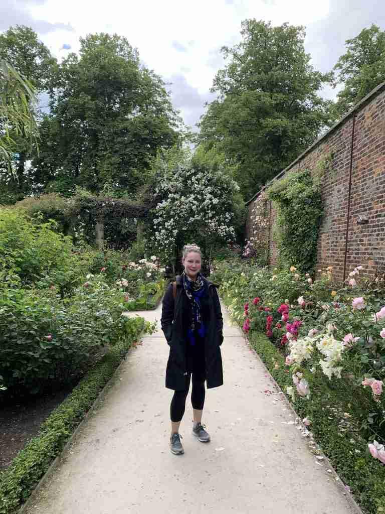 Solo female traveler in rose garden at Alnwick Castle