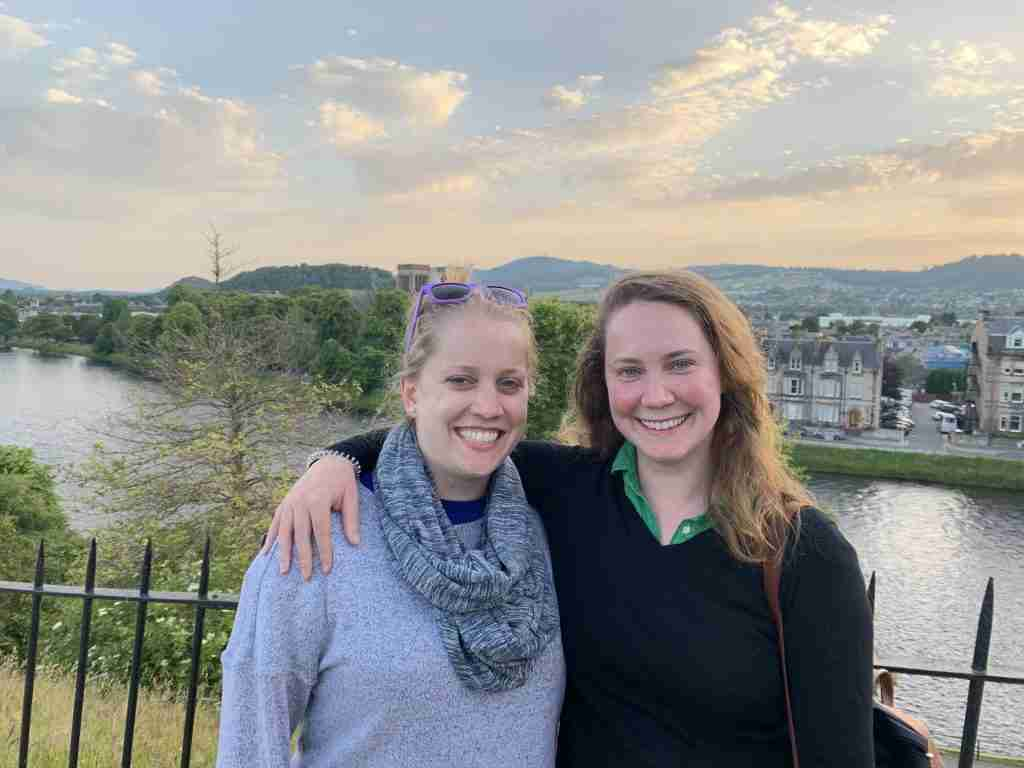 Two women at sunset in Inverness overlooking the River Ness.