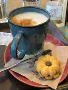 A cappuccino and a cookie at a cafe in Athens Greece Greek coffee culture