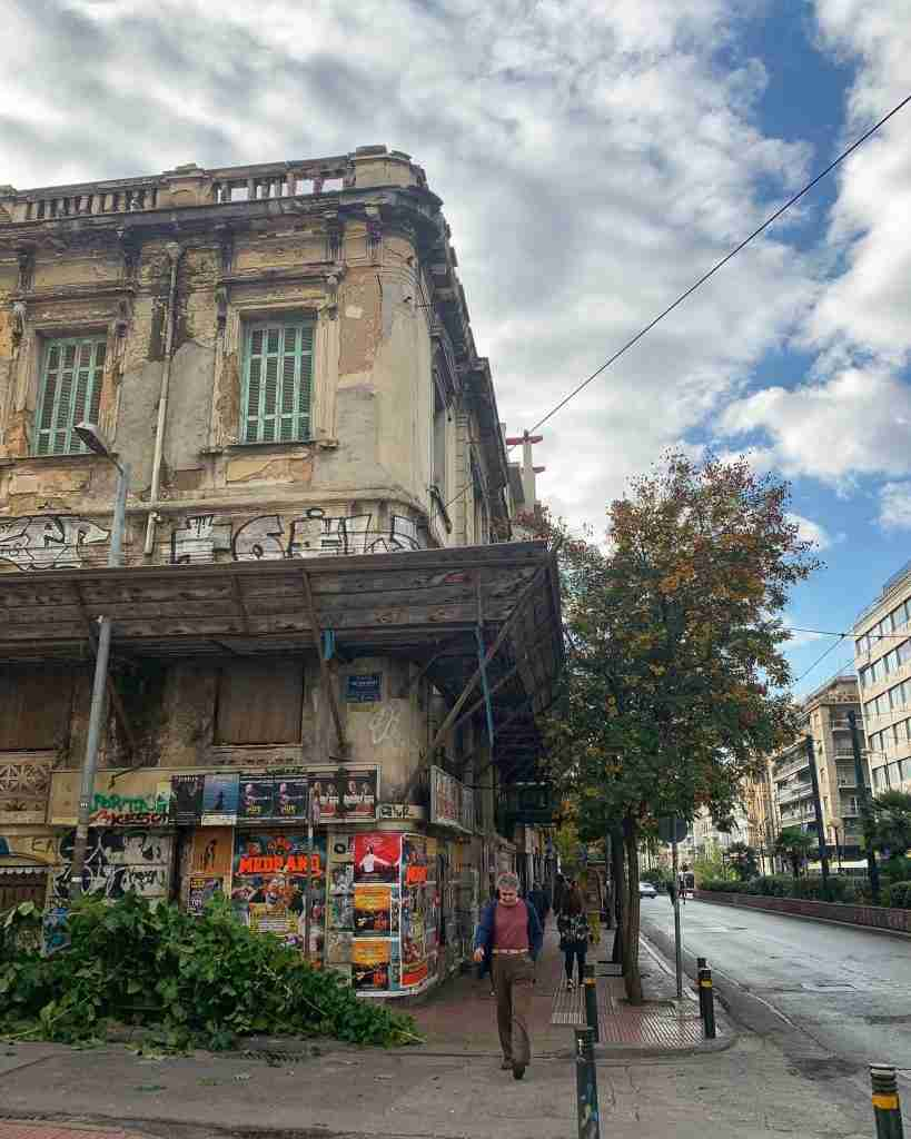 A crumbling Neoclassical mansion in Athens Greece covered in graffiti