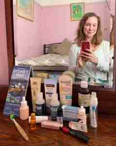 Solo female traveler with carry on beauty products