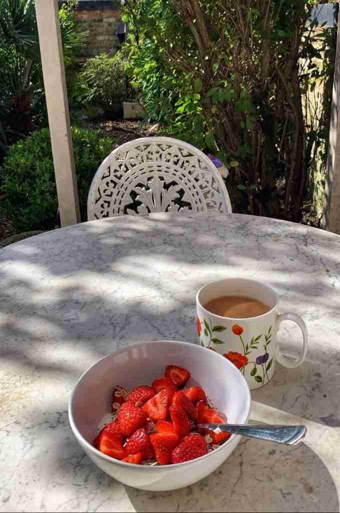 British strawberries with yogurt and tea in a London garden