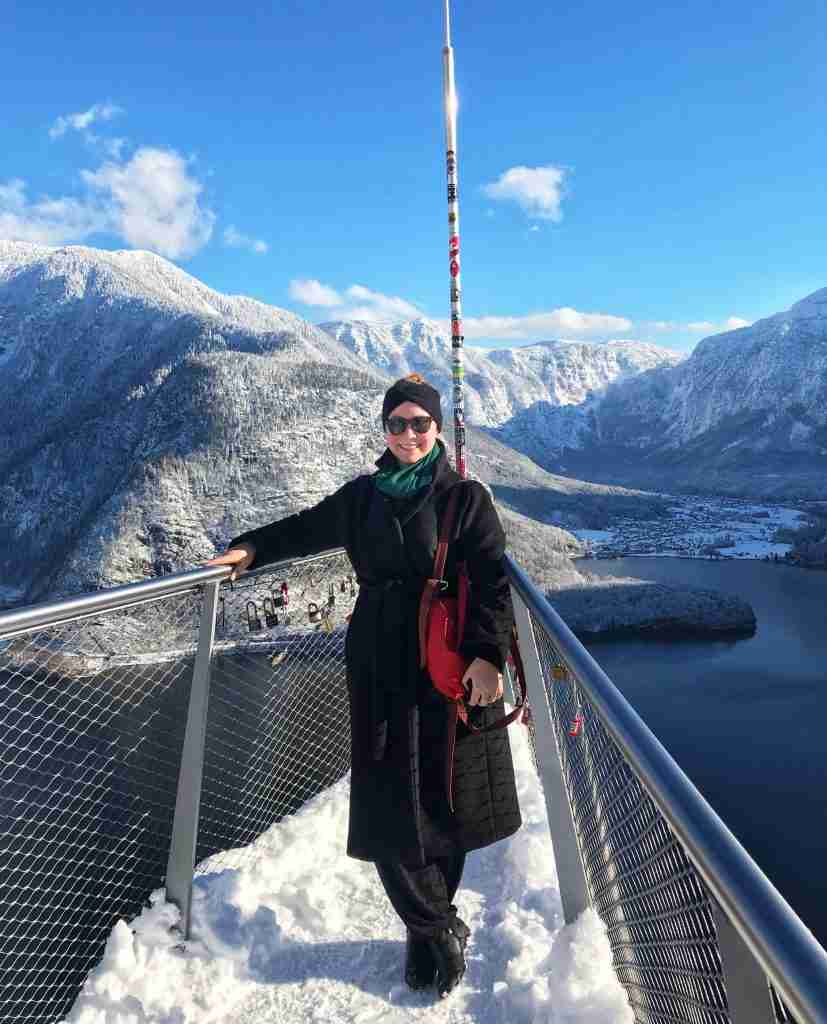 A solo female traveler in Hallstatt Alpine village in Austria in winter