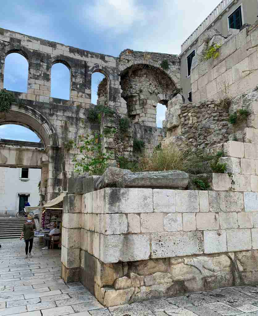 Diocletian's Palace in the old town of Split, Croatia at the Silver Gate entrance with ancient Roman arches